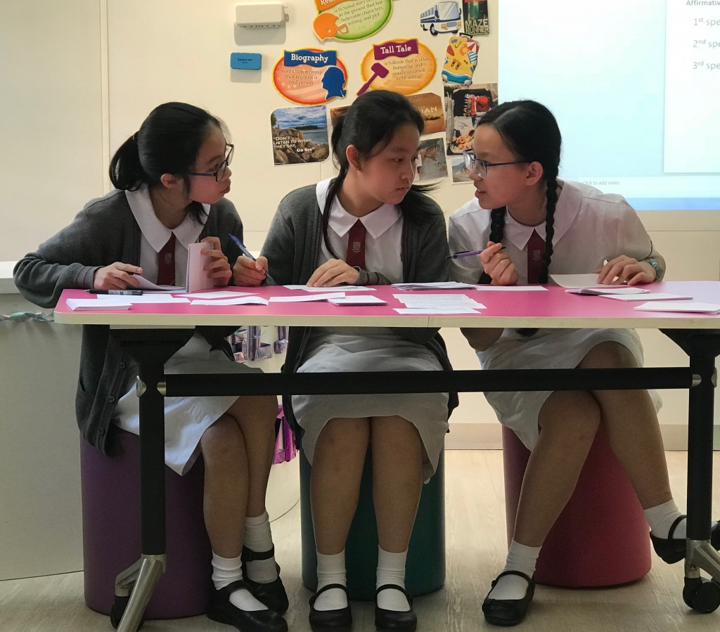 2B Fiona Chen, 2A Michelle Mak and 2D Kennis Cheung in the HKPTU English Debating Competition