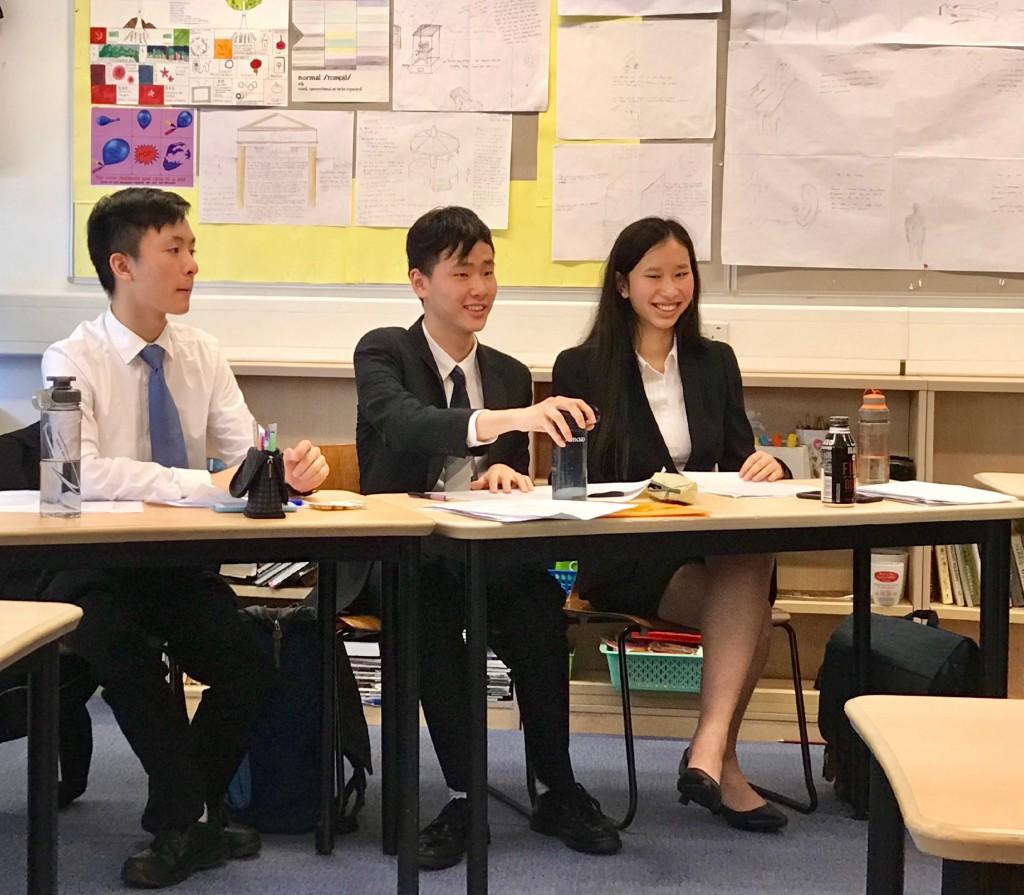 5B Isaac Lee, 6B David Tse and 5A June Kan debating in the quarter-finals in the Senior Debating Championships